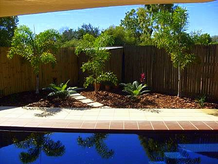 Landscaped yard with pool Northern Land Design